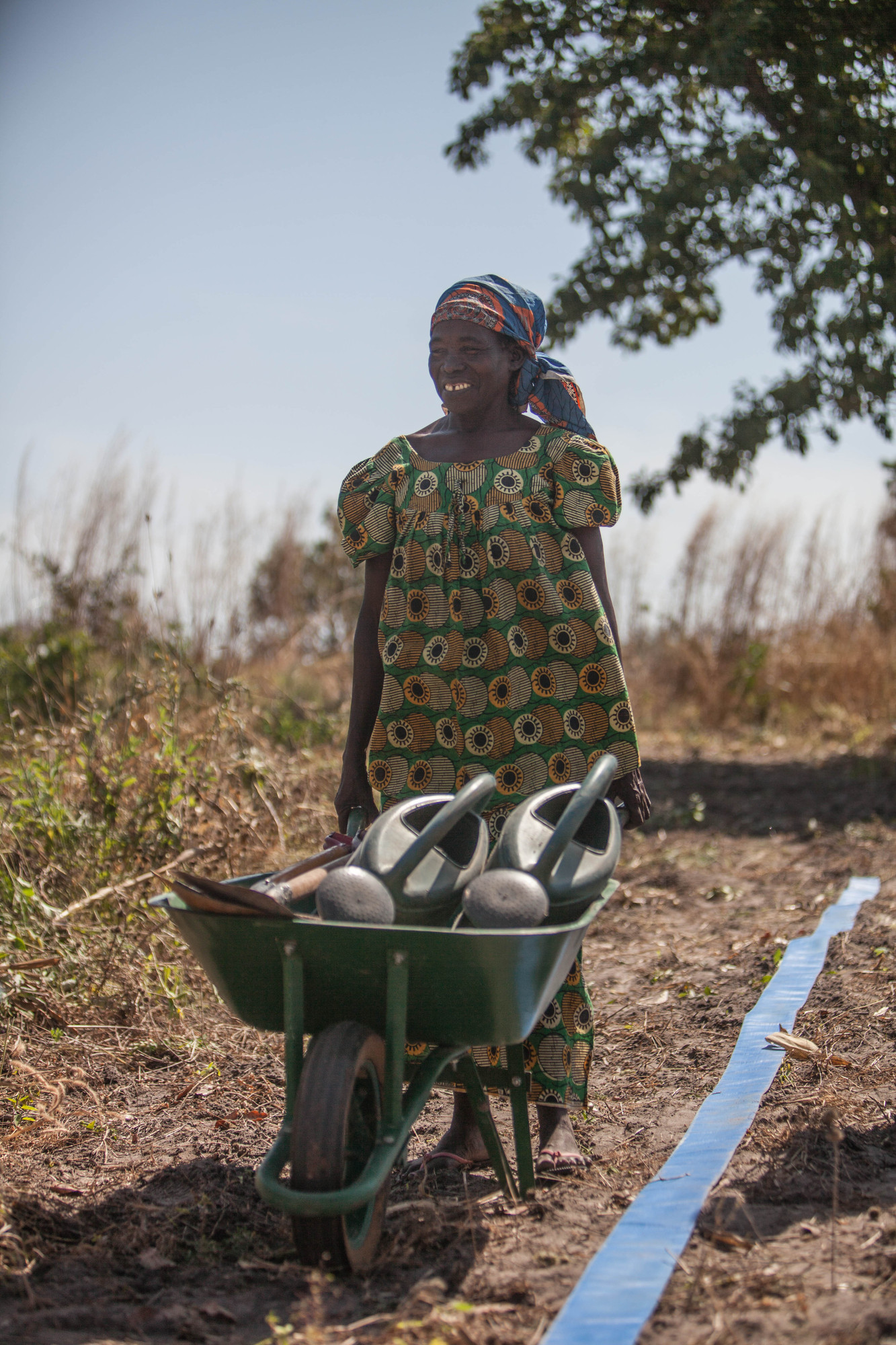 With tools and an irrigation hose from MCC, Koutou Melanie and other women cultivate vegetables in the dry season.