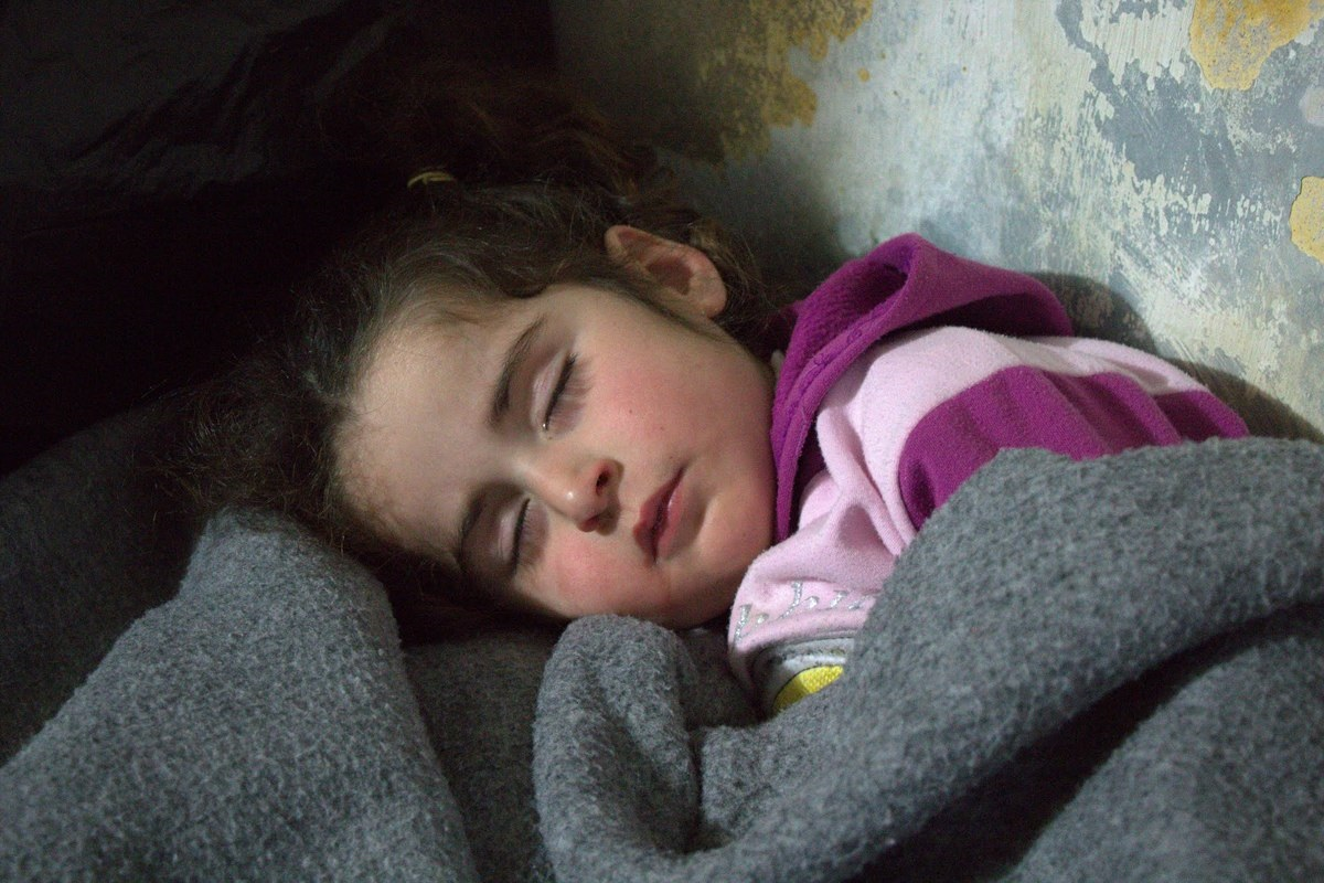 Rifaat's daughter sleeps in the corner of their apartment. The family's full names are not being used for security reasons.