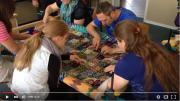 Last year, a group of Russian-German Mennonites held a retreat in Denmark to learn how to make comforters to donate to MCC. Watch them tie the layers of the comforter together. 0:10
