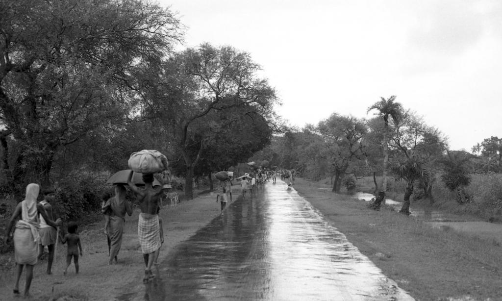 """<span class=""""photo-caption"""">MCC's work in Bangladesh began in the midst of turmoil. After a devastating cyclone in 1970, MCC started relief work in what was then East Pakistan, providing assistance through the upheavals that led to Bangladesh's independence in December 1971. During the peak of the civil war in 1971, MCC left East Pakistan but continued to assist refugees who, like these in this 1971 photo, fled from East Pakistan to India.</span><span class=""""photo-credit"""">MCC Photo/Vernon Reimer</span>"""