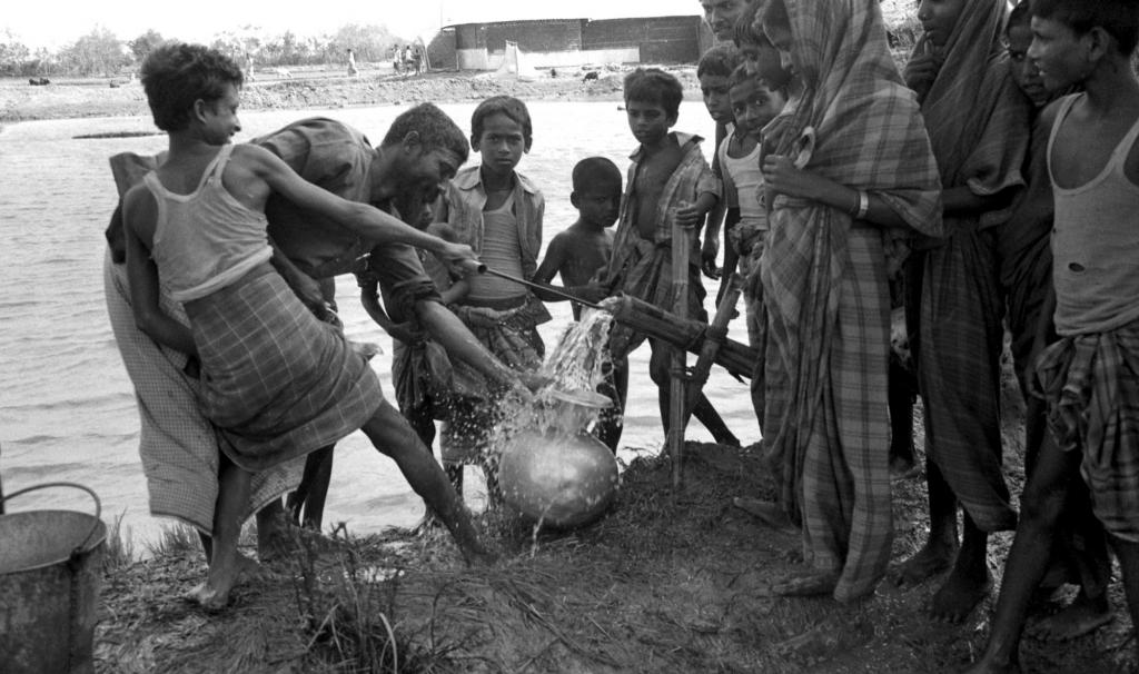 """<span class=""""photo-caption"""">The rower pump brought new opportunity to thousands of families in Bangladesh and eventually in other locations. After a 1985 cyclone filled ponds with salt water, MCCinstalled several pumpstofilter the water through a sand layerto purify it. Rower pumps also gave farmers a way to irrigate half an acre of rice or as much as two to three acres of vegetables. The rowing action was easy to operateand the cost was low enough that farmers could afford it.</span><span class=""""photo-credit"""">MCC Photo/Tim Meyer</span>"""