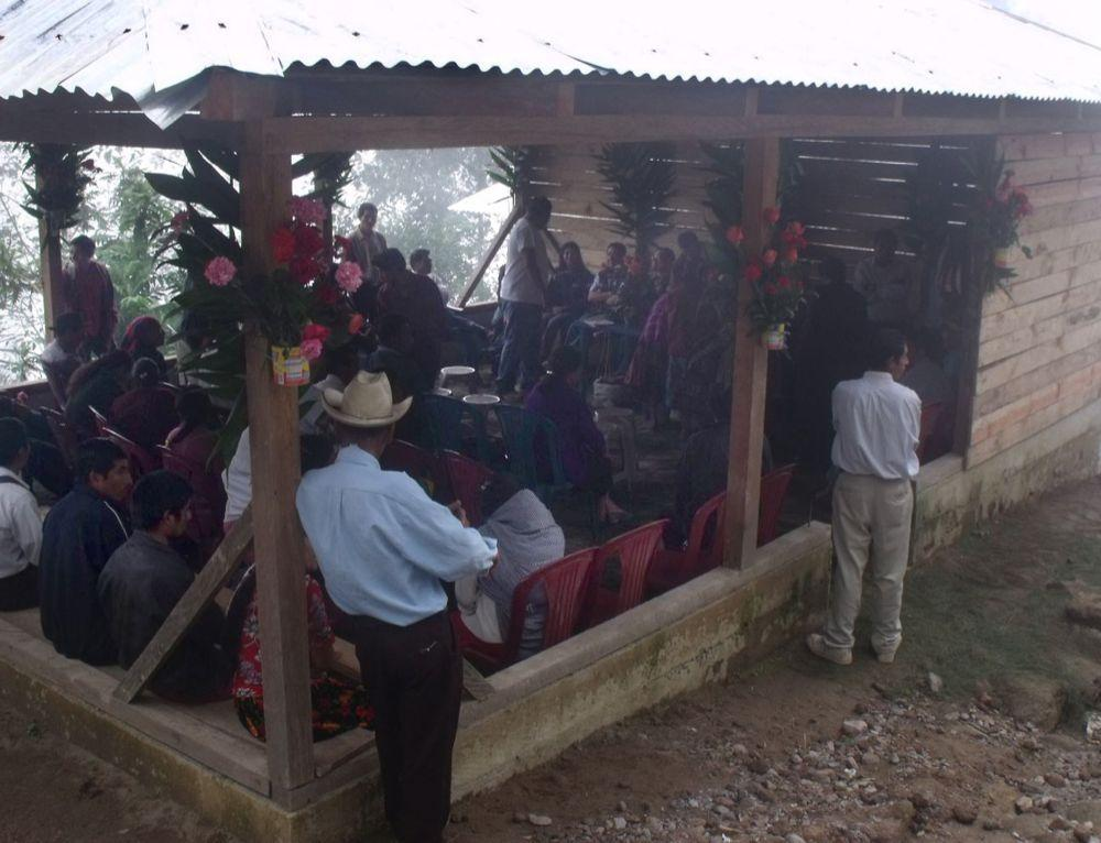 """<span class=""""photo-caption"""">A crowd of farmers gathers at a meeting of the La Linea Cooperative in Sibinal, Guatemala, in March. Primarily focused on the production and sale of flowers, this cooperative is also working on creating a space to sell local produce and promoting ecotourism, since it is near the Tacana volcano. MCC supports the development of this cooperative, in partnership with the San Marcos Diocese, as a way to strengthen the economic and food security in Sibinal.</span><span class=""""photo-credit"""">MCC Photo/Maggie Roblero</span>"""