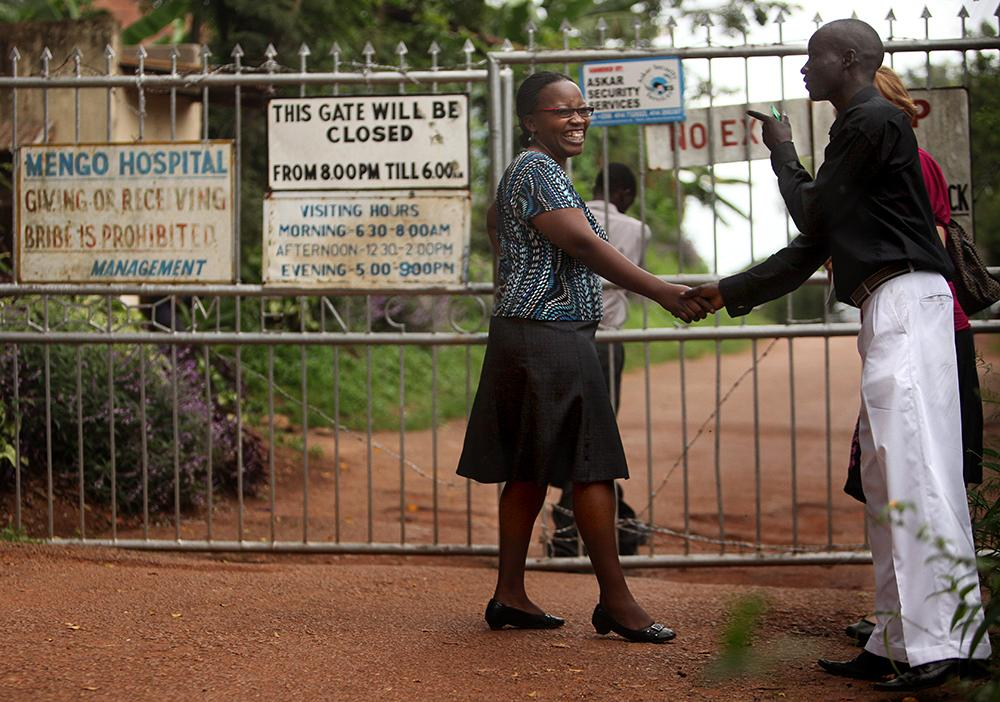 """<span class=""""photo-caption"""">When 19-year-old Samuel Baguma, shown talking with Mengo clinic's Dr. Margaret Mbabazi, first learned he was HIV-positive, """"I thought to myself, should I kill myself or what?"""" He gradually found hope through Mengo clinic and now helps lead small-group discussions for the club for young adults with HIV. He says. """"When you are taking medicine well and you are not missing your appointments, you can live."""" Read more in the fall issue of A Common Place magazine.</span><span class=""""photo-credit"""">MCC Photo/Silas Crews</span>"""