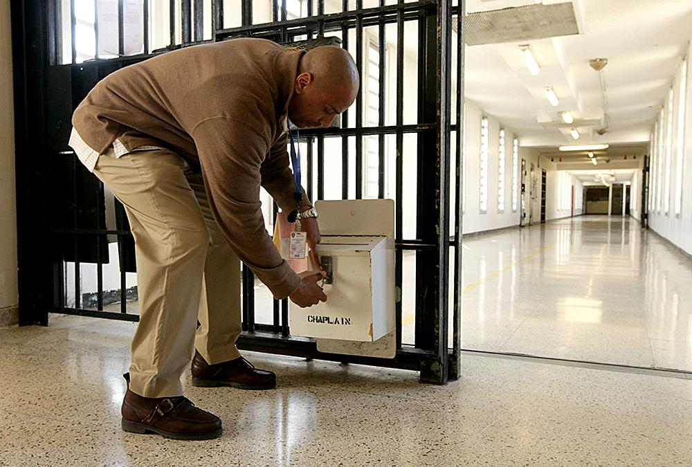 """<span class=""""photo-caption"""">Ron Muse, of North Philadelphia, checks a chaplain request box for new letters. Muse works at the prison 10 hours a week, meeting with prisoners and leading a Bible study. Muse, by building relationships in prison and on the streets, is laying a foundation for peace in an area where arrests and addiction are common.</span><span class=""""photo-credit"""">MCC Photo/Silas Crews</span>"""