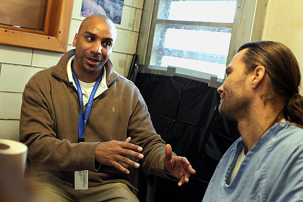 """<span class=""""photo-caption"""">Muse counsels Doerr in ways to grow spiritually during his time in prison. As a youth, Muse was involved in illegal activity. He feels this experience helps him identify with the inmates.</span><span class=""""photo-credit"""">MCC Photo/Silas Crews</span>"""