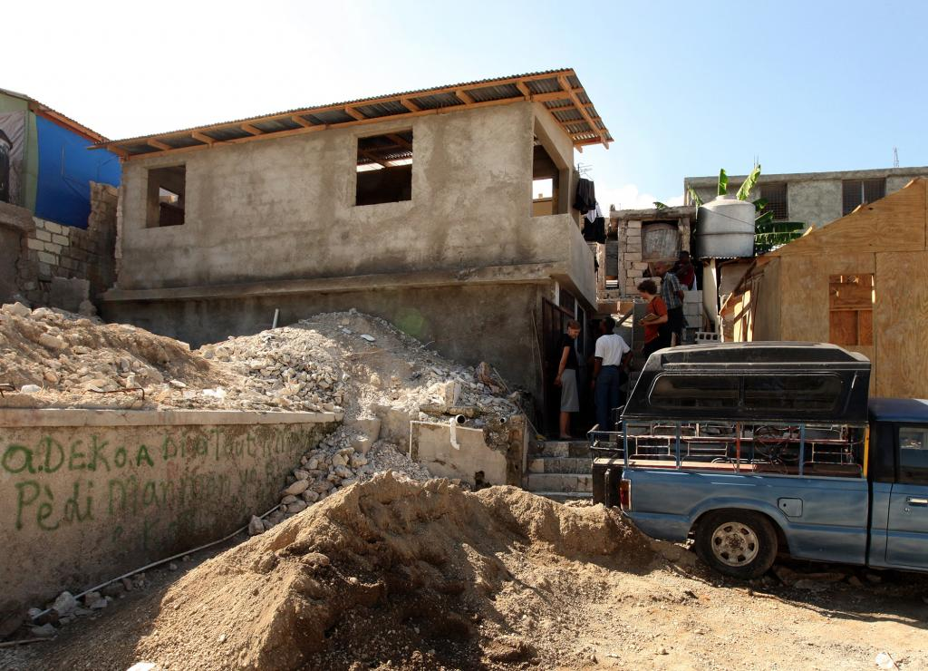 """<span class=""""photo-caption"""">A newly repaired home, left, made possible by MCC partner ACCESS with funding from MCC's earthquake response effort, stands nearly finished in the Boulard neighborhood of Port-au-Prince, Haiti.</span><span class=""""photo-credit"""">MCC Photo/Silas Crews</span>"""