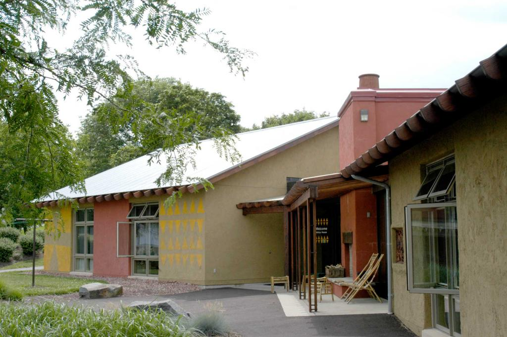 "<span class=""photo-caption"">Each of the four Welcoming Place guest houses features arts and handicrafts from one of the major program areas where MCC works: Africa, Asia, the Americas and Middle East/Europe. This photo is an exterior view of Africa house.</span><span class=""photo-credit"">MCC Photo </span>"