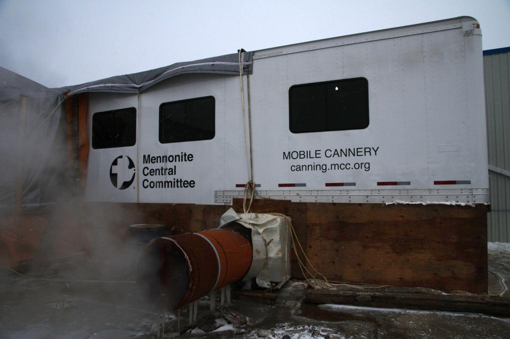 "<span class=""photo-caption"">Step 1: The mobile cannery arrives at the location, is unfolded and attached to a building. </span><span class=""photo-credit"">MCC photo/Anthony J. Siemens</span>"