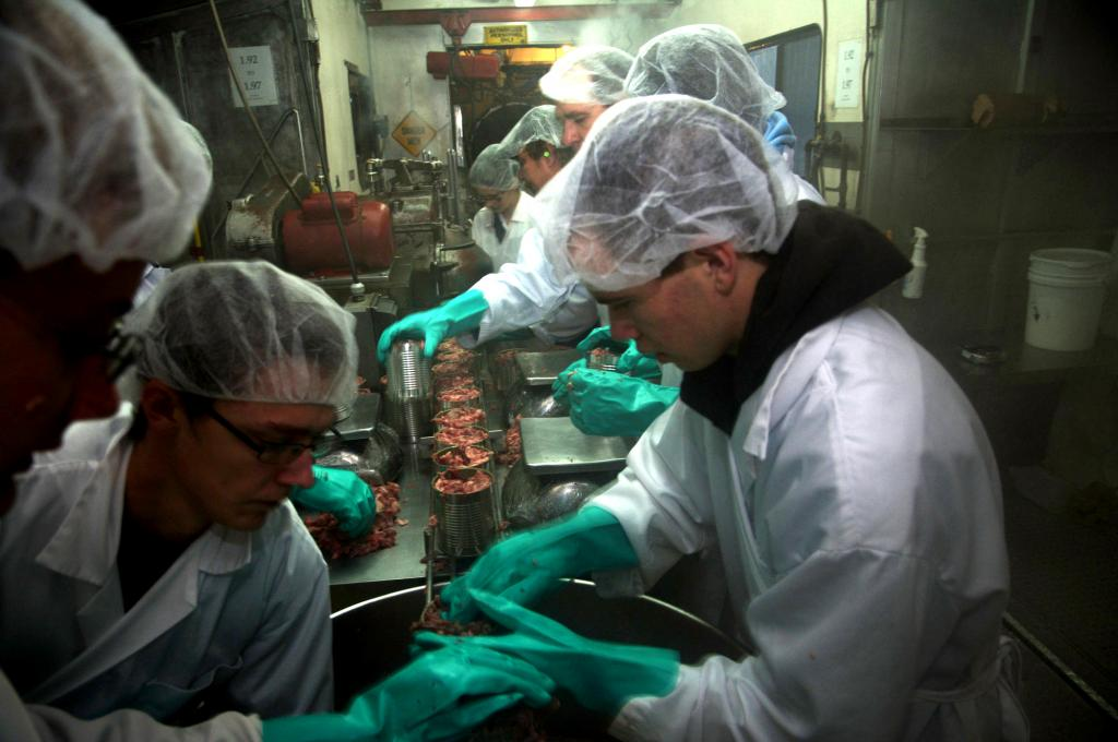 "<span class=""photo-caption"">Step 4: Once the meat is at the correct temperature, volunteers put the meat into cans. </span><span class=""photo-credit"">MCC photo/Anthony J. Siemens</span>"