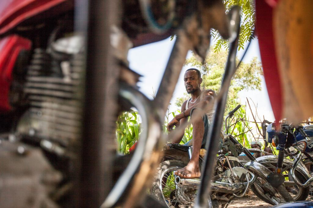 """<span class=""""photo-caption"""">In the rural Haitian town of Desarmes, 28-year-old Dieunold Sterling's yard is filled with motorbikes he now has the knowledge to repair, each job a step toward his dream of establishing a full-service garage. Five years after a devastating earthquake, MCC's Haitian partners have helped thousands of people find new opportunities in rural areas and get back on their feet in the capital city. (Learn more about Sterling and other vocational school graduates in photos 9-12.)</span><span class=""""photo-credit"""">Silas Crews</span>"""