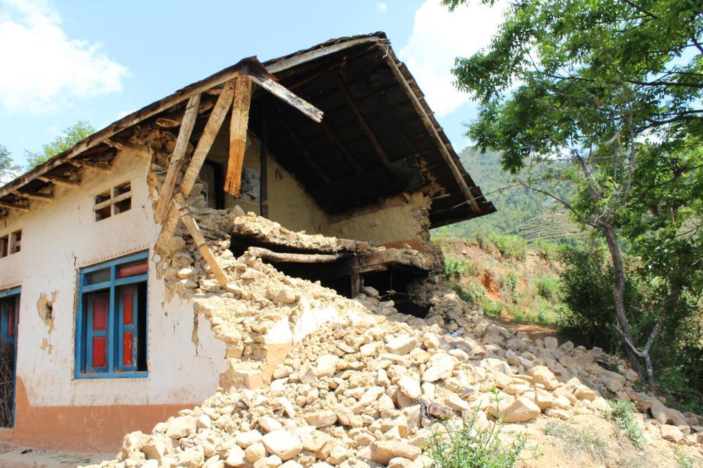 "<span class=""photo-caption"">AnitaLama's house after the earthquake.</span><span class=""photo-credit"">MCC photo/Binod Deshar</span>"