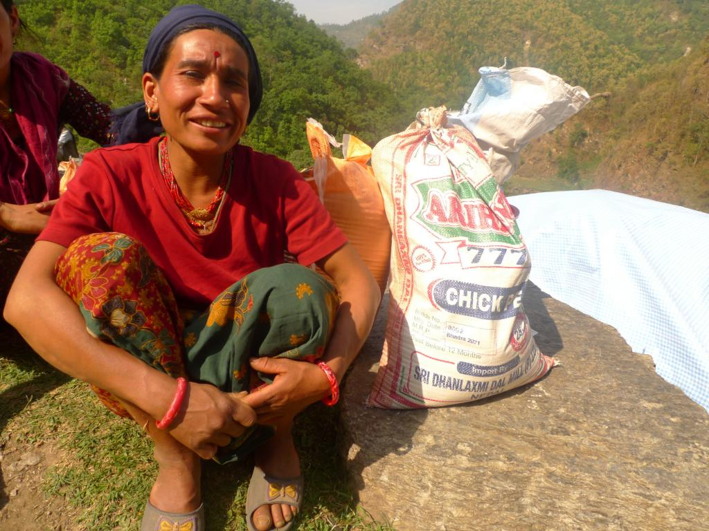 "<span class=""photo-caption"">Burnamay Khatri, age 28, received relief food from MCC through local partner Group of Helping Hands in Okhaldhunga. Khatri's home was destroyed after the earthquake. She has three children. </span><span class=""photo-credit"">MCC Photo/Durga Sunchiuri</span>"