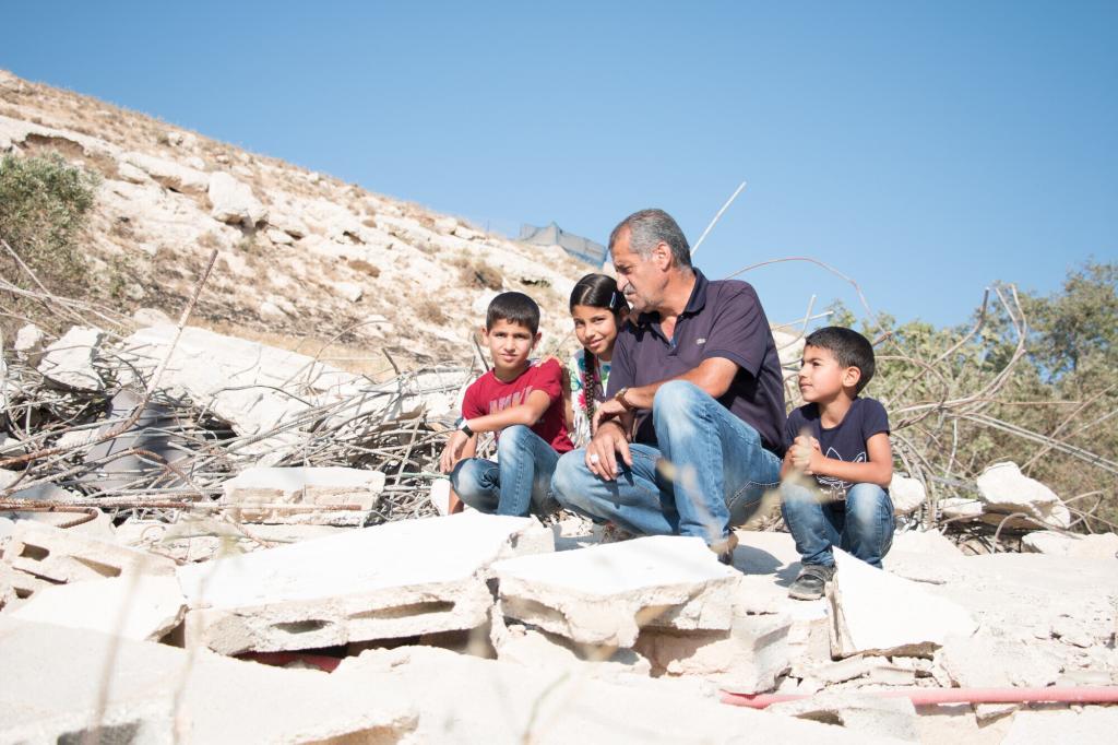 "<span class=""photo-caption""><a href=""https://mcc.org/stories/wrestling-roots-palestinian-israeli-conflict"">Wrestling with roots of the Palestinian-Israeli conflict</a></span><span class=""photo-credit"">MCC Photo / Meghan Mast</span>"