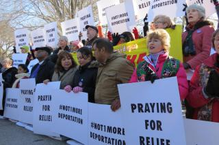 Faith leaders praying at the White House