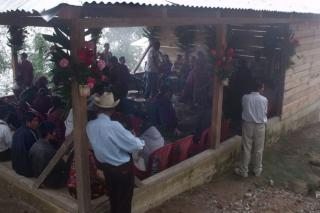 A crowd of farmers gathers at a meeting of the La Linea Cooperative in Sibinal, Guatemala