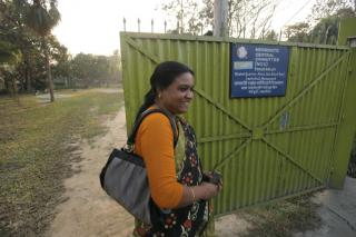 Ferdoushi Howlader, MCC Bangladesh job creation project supervisor, walks past the entrance to MCC's research and design facility in Mymensingh, Bangladesh.