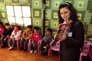 Kids House teacher Miss Ashwoq reads to her students in a classroom tent in Ankawa, a Christian suburb in Erbil, northern Iraq.