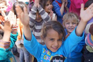 This Syrian girl, whose name is withheld for security reasons, was singing, playing musical chairs and painting on the March day when MCC visited the temporary Lebanon community where she lives. The activities were coordinated by MCC's partner, Development for People and Nature Association, to bring a sense of normalcy and pleasure into the lives of refugee children.