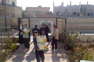 Earlier this year, these men unloaded boxes of oil in a Syrian town that were used as part of food packages distributed in Syria. They are unnamed for their security. Throughout the past two and half years of civil unrest in Syria, Mennonite Central Committee has been distributing food, blankets, hygiene supplies and other support to Syrians who have been affected by the violence.