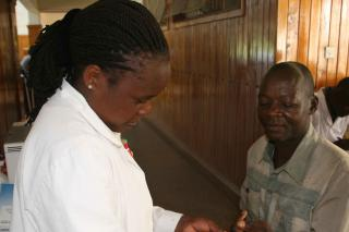 Moses Barasa, pictured with diabetes educator Sheila Tanui, is one of some 450 diabetic patients benefiting from an MCC-supported project in Webuye, Kenya.