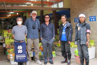 "Mr. William, far left, owns Moriya Fruits Shop in Ishinomaki City, Miyagi Prefecture. His shop has been reclaimed from tsunami damage and is again open to serve the community. Also pictured are (left-right), Willie Reimer, MCC; Takeshi Komino, CWS; Shingo Kobayashi, who heads CWS' implementing partner organization in the city; and volunteer ""Dancho"" (nickname; name not known)."