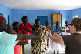 Kaitlyn Jantzi, right, MCC worker in Rumbek, Sudan, leads the women's group at Holy Cross Centre in Rumbek in trauma healing exercises. Many people in southern Sudan continue to deal with trauma from 20 years of civil war and ongoing conflicts between southern ethnic groups. Jantzi is from St. Clements, Ont..
