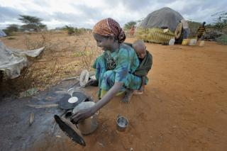 Ahada Kusoco Hassan, 23, cooks breakfast for her family in the Dadaab refugee camp in northeastern Kenya.