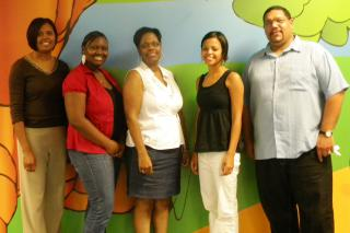 Eboni Gibson, second from left, was supported in her Summer Service Worker program by Kenyetta Twine, human resource director of Calvary Community Church; Denise Gibson, director of the summer day camp where Eboni Gibson served; Kim Dyer, coordinator of MCC U.S.' Summer Service Worker program; and the Rev. Flinn Ranchod, an MCC East Coast board member.