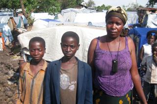 Mbonye Buhunda, 38, her husband and their six children, including Mapenli, 11 and Ishara, 13, pictured, have been displaced repeatedly. Within the past several months, they fled their home in North Kivu, lived in tents at a school near Goma for two months, tried to return home in mid-November but were chased back to the school in Goma, only to run again when rebel group M23 took over Goma.