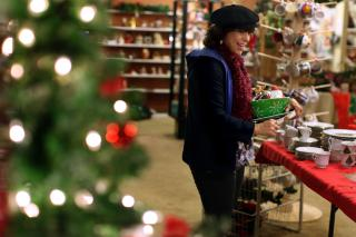 Cherise Kovack, of Brownstown, Pa., shops for Christmas decorations at the Re-Uzit Shop of New Holland (Pa.) on Nov. 29.