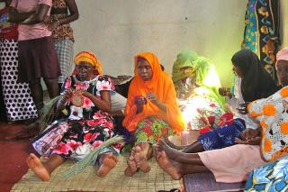Working together to produce handicrafts for income generation, like these Rwandese women are doing, is an important step toward building trust while working on projects that will bring in money for their families and community. Peace and Durable Development (PDD) supported the organization of this group.