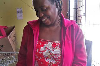 Petronella Bahati Nziriere, director of the Children Care Center, takes Moses home for evenings and weekends.