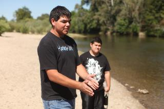 In preparation for Summer Service, Micah Hart, Cordell, Okla., participated in Global Anabaptist Peacemakers training offered by West Coast MCC along with most other Summer Service participants from MCC Central States and West Coast MCC. In this Care for Creation class, Hart explains a concept as Armando Lara, of Sanger, Calif., right, listens in the background.