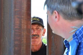 Talking through the border fence