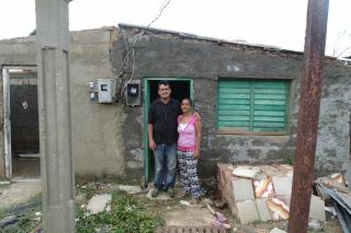 Yoel Balbusano and his wife Daily outside their home in Caibareín, Cuba
