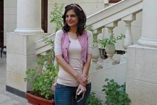 Hala Al Hamida stands in a courtyard
