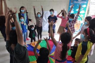 Children from the neighborhood of Chamelecón, San Pedro Sula, Honduras, are learning breathing exercises to use in managing the trauma of living through Hurricane Eta and Iota that struck within two weeks in November 2020. The daily workshops, led by trauma specialist Claudina Lacayo (not pictured) were held for two weeks in early December at Iglesia Vida en Abundancia (Church of Life in Abundance)