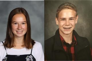 Side by side school headshots of a young woman in a black and white top and a young man in a red plaid shirt with a black vest both smiling and looking into the camera. Against a gray background.