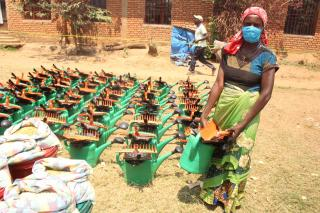 Top photo: In the Democratic Republic of the Congo in September 2020, Riziki Mpendacheko, along with other displaced people and local families in need, received an agriculture toolkit. Photo/Kabamba Lwamba