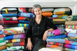 Karen Kreider Yoder surrounded by comforters that she has since donated to MCC in honor of 60th birthday