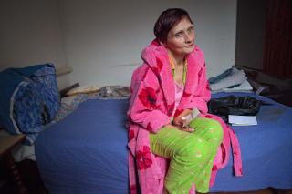 Oksana Plekhuan sits on her bed.