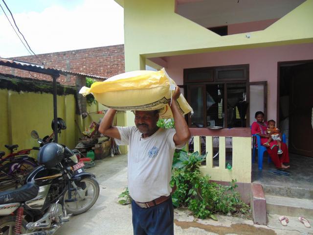 Man receiving food relief in Nepal
