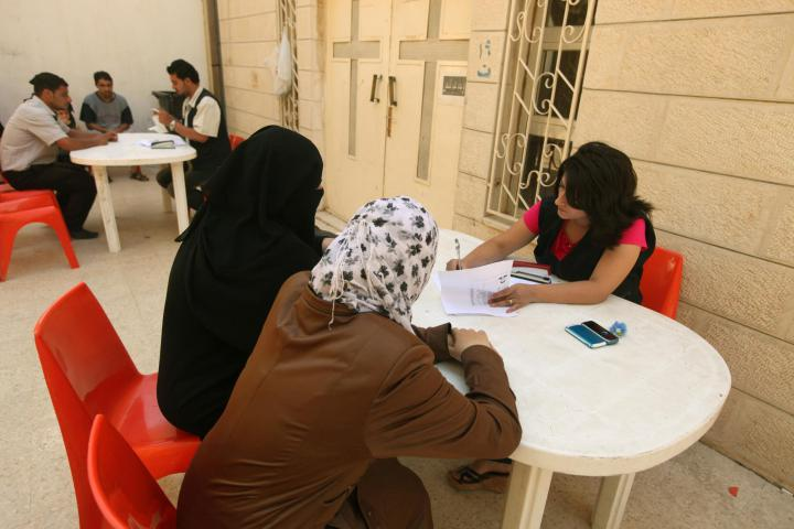 """<span>Ruba Haddad, Caritas Jordan case worker, meets with Syrian refugees at a Caritas community center in Mafraq, Jordan. MCC works with Caritas Jordan by providing material aid for Syrian refugees arriving in Jordan. Caritas Jordan also provides services for refugees from other countries.</span><a href=""""http://acommonplace.mcc.org/acp/2013/01_03/cover_story.html"""">Read more</a><span>about this work in the Winter issue of A Common Place, MCC's quarterly magazine.</span>"""