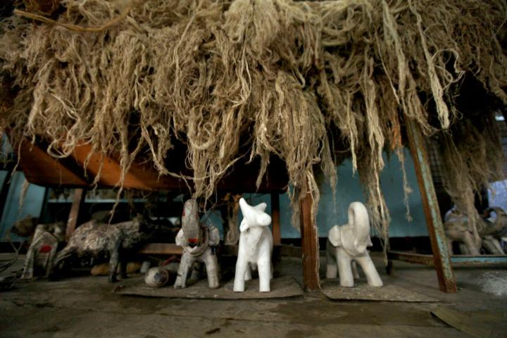 Banana fiber and papier-mâché animals both dry before they are turned into final products. The research and design center does not mass-produce products. The goal is to create new products and create new jobs through this research.