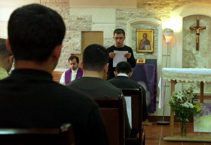 St. Peter's Seminary student Hans Shamoaay reads a bible passage in English during a morning church service at the seminary. The young seminarians are eager to learn the English language so that they can read and study a wider selection of books, establish relationships with people from other countries and share the history and experiences of Iraqi Christians with people in other countries.