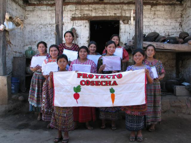 In another MCC Guatemala food security project, Project Harvest, women learned to plant their own vegetables using organic fertilizers and pesticide, and other environmentally friendly techniques that boost food production. The graduates hold the certificates they were given in January 2011 after completing a year of hands-on training. Project Harvest is an MCC-supported program in the Casa Blanca and Xecaja communities in the Totonicapán district of Guatemala.