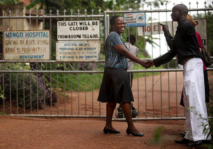 "When 19-year-old Samuel Baguma, shown talking with Mengo clinic's Dr. Margaret Mbabazi, first learned he was HIV-positive, ""I thought to myself, should I kill myself or what?"" He gradually found hope through Mengo clinic and now helps lead small-group discussions for the club for young adults with HIV. He says. ""When you are taking medicine well and you are not missing your appointments, you can live."" Read more in the fall issue of A Common Place magazine."