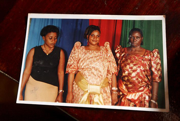Photographs show a healthier time for 38-year-old Aisha Nabiyisha, who is in the middle in this family photo. Today, Nabiyisha, who receives regular home care visits, urges others to be tested for HIV and get access to medical treatment.