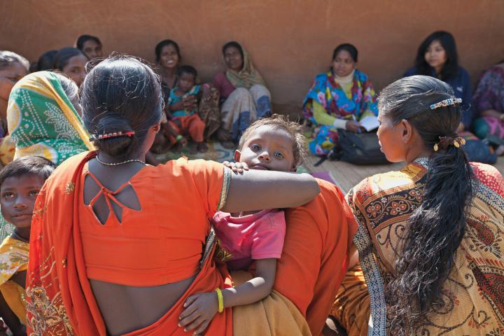 In addition to training farmers in new agricultural techniques, SVWSThelps communities to organize themselves to share resources, work together and participate in programs such as government-funded efforts for rural development. A first step is establishing a farmers' group, women's group and youth group in each village. Sapna Tirkey and her two-year-old daughter Swati join a women's group meeting in Rurungkocha.