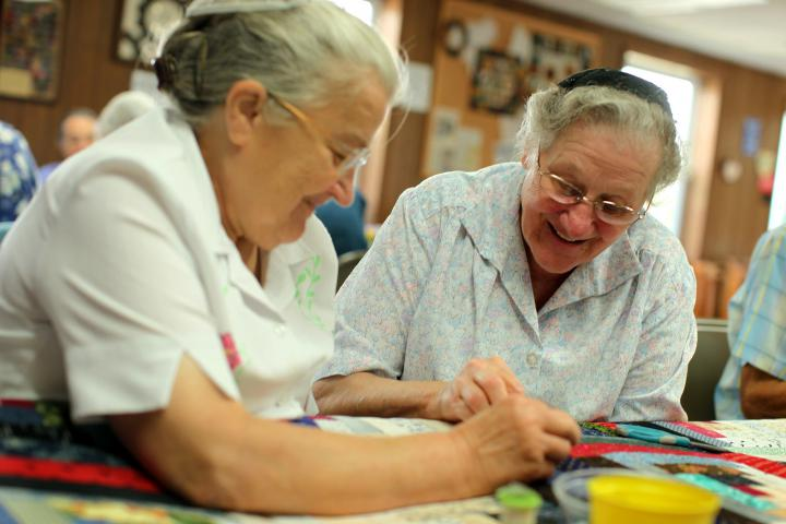 Anna Stauffer (left) and Miriam Witmer (right) volunteer at the MCC Material Resources Center in Ephrata, Pa.